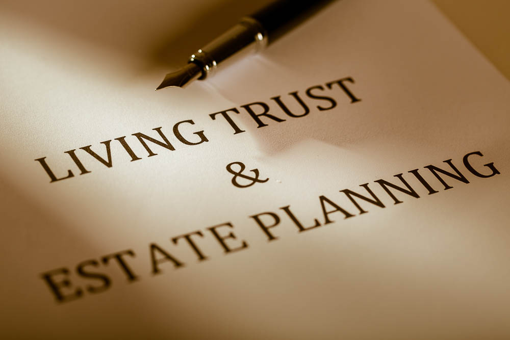 """Fountain Pen Lying on the """"Living Trust and Estate Planning"""" - Close Up"""